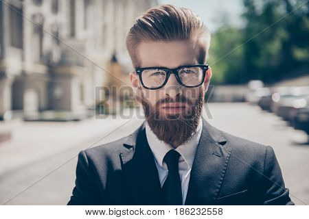 Close Up Portrait Of A Successful Young Red Bearded Guy In Suit And Glasses. So Stylish And Nerdy. O