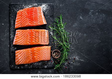 Raw salmon filet on dark slate background wild atlantic fish