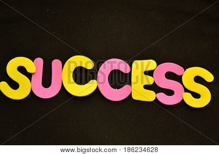 word success on a  abstract black background