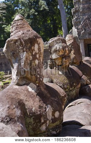 A row of Buddha Figures at Preah Khan Temple.