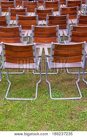 Empty, Wooden Metal Chairs Of An Open Air Garden Theater From Back, Vertical