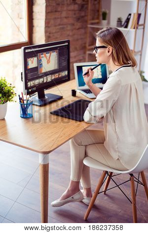 Vertical Photo Of Attractive Young Photographer Working With Computer At The Table And Retouching Wi