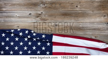 Flay lay view of USA flag on rustic wooden boards horizontal format