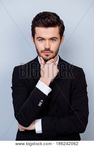 Vertical Photo Of Strict Serious Minded Boss In Formal Clothes Touching His Chin