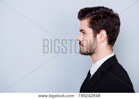 Side View Portrait Of Serious Concentrated Hansome Businessman In Formal Clothes Isolated On Gray Ba