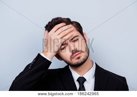 Close Up Portrait Of Troubled Unhappy Man In Formal-wear Touching His Forehead Because Of Having Hig