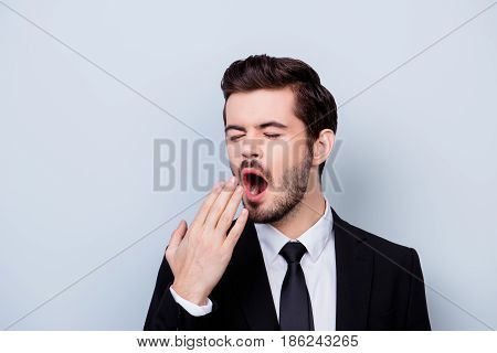 Close Up Portrait Of Bored In Formal Clothes Yawning Man Isolated On Gray Background