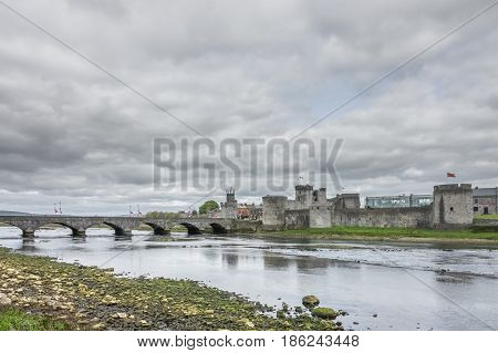 King Johns Castle and an old bridge over river Shannon, Limerick, Ireland