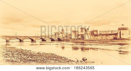 Stylized sepia image of a King Johns Castle and an old bridge over river Shannon, Limerick, Ireland