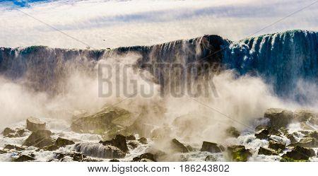 Water rushing over Niagara Falls New York USA