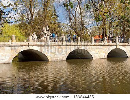 Monument on the bridge. Warsaw, Poland - April 08, 2017 Monument of Polish King Jan III Sobieski on bridge of pond in Łazienki Park in Warsaw.