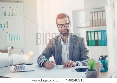 Stylish Smiling Architect In Formal Wear Has Ideas And Working With Blueprint Papers And Drawings In