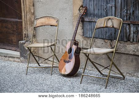 Guitar and chairs in Provence of France
