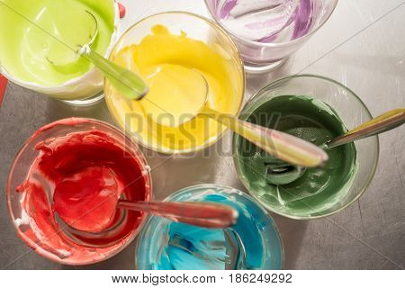 Glasses of various food coloring for making decorations on dishes or pastry for celebrating