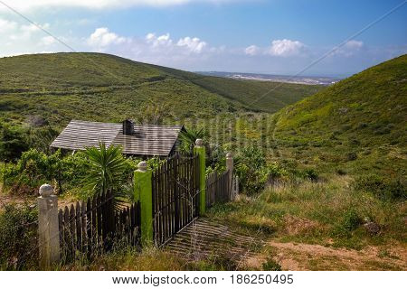 Roof and gate of a remote wooden shack in the hills