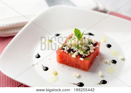 Watermelon and feta salad. This watermelon cubes salad is made with greek feta cheese crumbs olive slices mint olive oil and balsamic vinegar. So refreshing the perfect food for the summer!