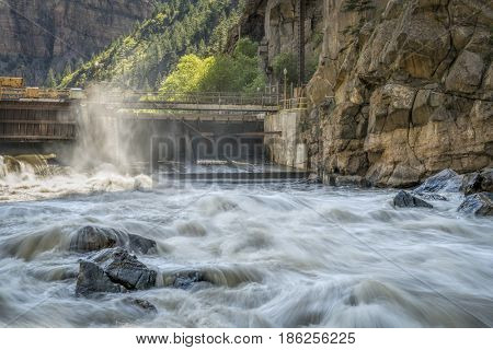 Colorado River flowing from an open gate of Shoshone Power Plant in Glenwood Canyon