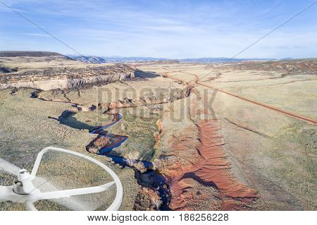 aerial photography concept - view of Colorado a creek at Colorado foothills with a drone propeller