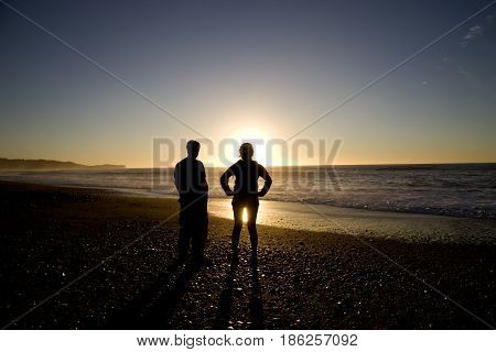 Sillouette People And Beach