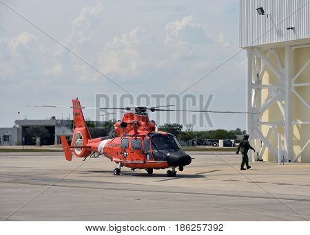 MIAMI - May 12 2017: US Coast Guard helicopter returns from patrol to its base in Miami Florida on May 12 2017. Opa Locka airport is host to a fleet of USCG helicopters.