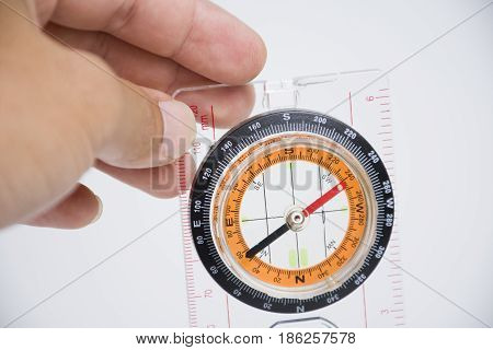 Hand catching Compass isolated on white background