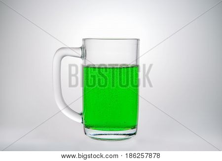 Cream soda syrup mixed with soda in glass with handle