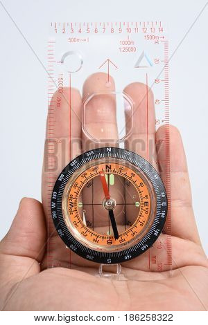 The compass in my hand on white background
