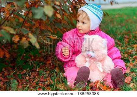 Little Girl Plays A Toy Bear