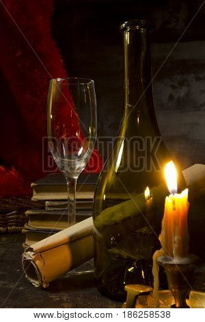 Vintage still life with wine and a candle