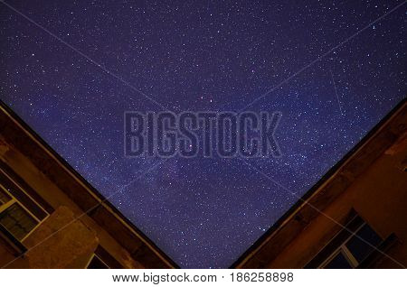 Starry sky and house in the foreground.
