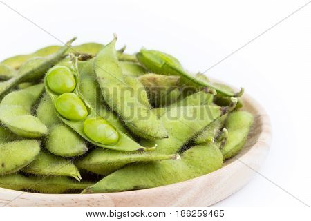 Green Soybean With Seeds (vegetable Soybean) Boiled In Wooden Plate On White