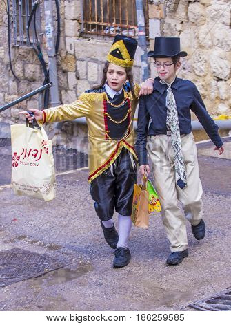 JERUSALEM - MARCH 13 : Ultra Orthodox boys during Purim in Mea Shearim Jerusalem on March 13 2017 Purim is a Jewish holiday celebrates the salvation of the jews from genocide in ancient Persia