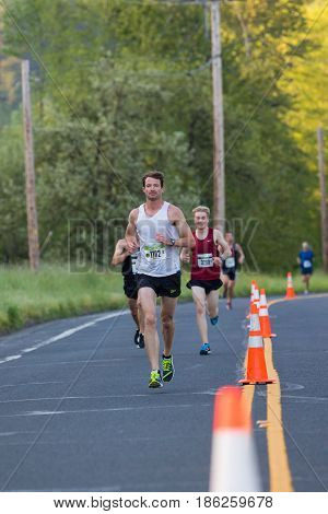 EUGENE, OR - MAY 7, 2017: Marathon winner Steve Dekoker at mile 6 of the 2017 Eugene Marathon race held on the University of Oregon campus. Dekoker places 1st with a time of 2:29:46.