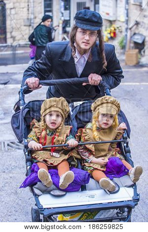 JERUSALEM - MARCH 13 : Ultra Orthodox family during Purim in Mea Shearim Jerusalem on March 13 2017 Purim is a Jewish holiday celebrates the salvation of the jews from genocide in ancient Persia