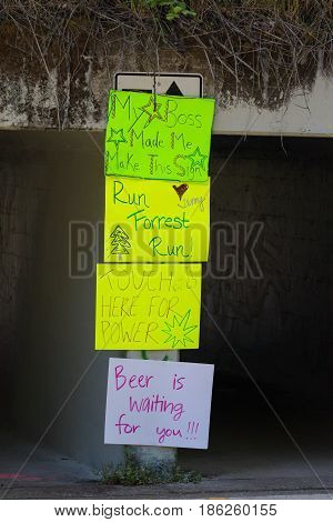 EUGENE, OR - MAY 7, 2017: Humorous signs posted along the course at the 2017 Eugene Marathon race held on the University of Oregon campus.