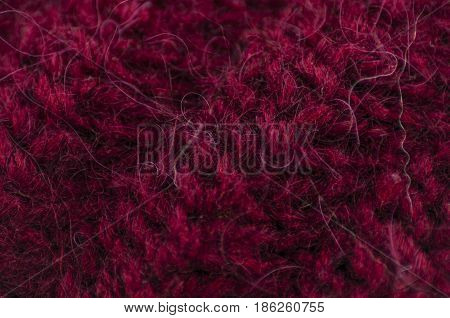 cloth of manual knitting with the diagonal drawing from yarn of claret color