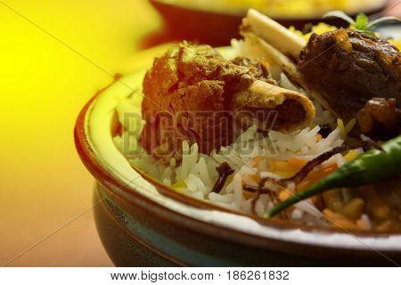 kashmiri Mutton Gosht Biryani / Lamb Biryani / Mutton Biryani served with Yogurt dip, selective focus