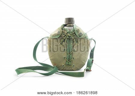 World war army water canteen with dirty green cover on a white background