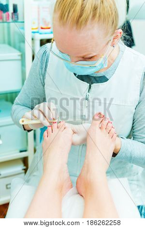 People at work. Photo of pedicure procedure in process.