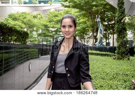 Young businesswomen look good on the outside background.