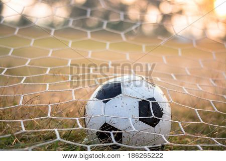 Close up of soccer ball in goal