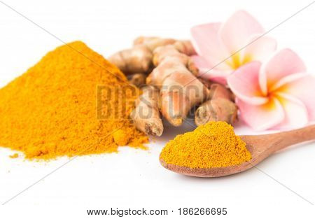 Closeup turmeric powder and turmeric roots on white background for spa skin care beauty concept selective focus