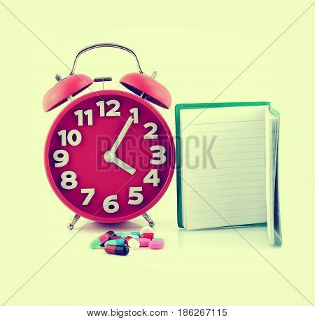 clock and pills for healthcare medicine isloated