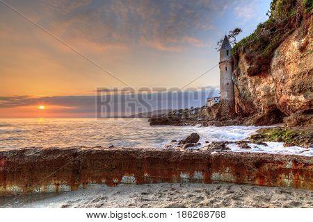 Sunset Over Pirates Tower At Victoria Beach In Laguna Beach