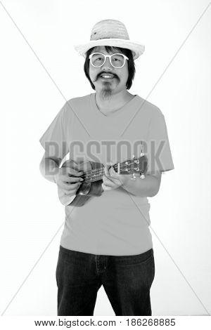 Portrait of musician man with ukulele isolated