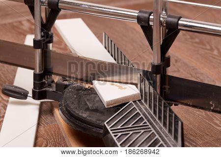 Handsaw and mitre box on linoleum floor. Home repair. Carpentry Tools.