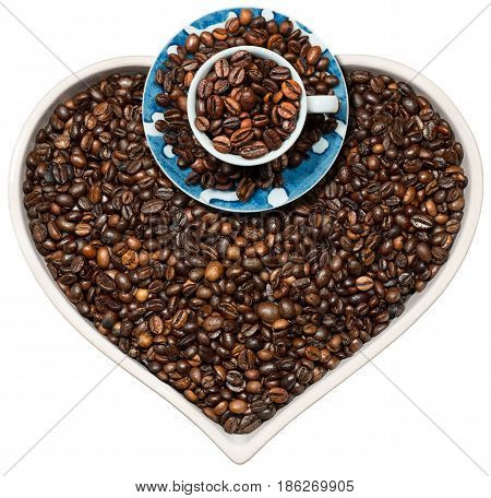 Roasted coffee beans in a heart shaped bowl and a coffee cup isolated on a white background. Love Coffee concept
