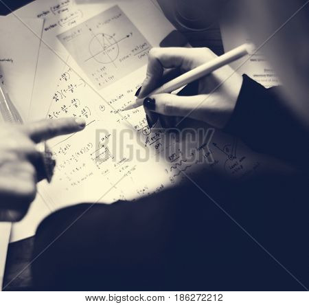 Hand Writing Working on Physics Assignment Study Education