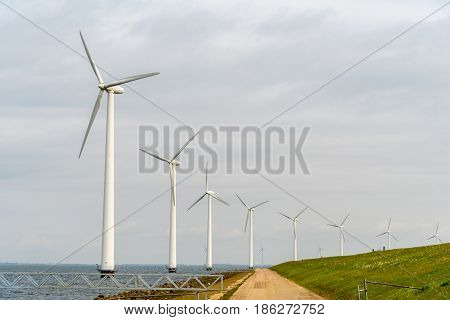 Large view on the windmills at the shore