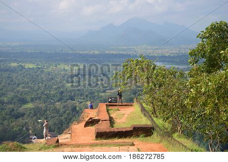 SIGIRIA, SRI LANKA - MARCH 16, 2015: European tourists on the ancient ruins of the royal palace on top of the Sigiriya mountain